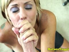 Blonde cougar milf tittyfucks and tugs
