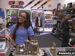 Geeky babe showing her pussy at the pawn shop